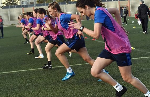 female referees running football fitness test